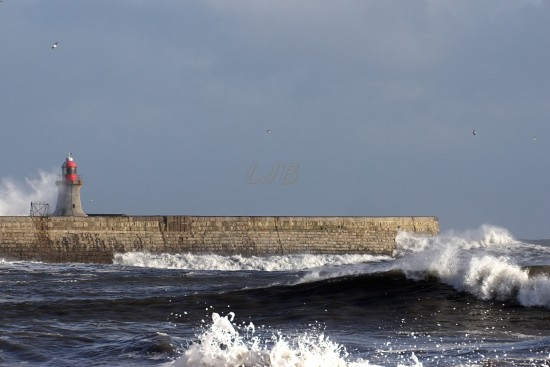 Waves breaking over South Shields Lighthouse, River Tyne