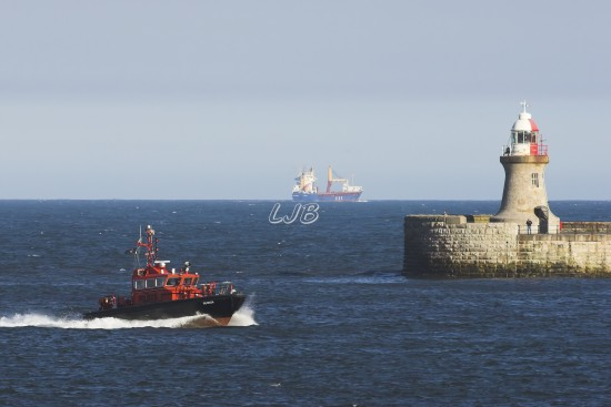 Tyne Pilot Boat passing South Shields Lighthouse, River Tyne